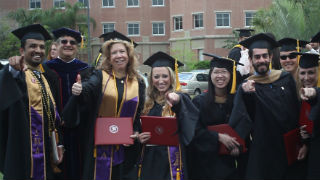 MBA Degree graduates at their graduation - preview image